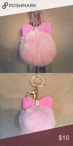 Rabbit head keychain. Super soft bunny  keychain /purse charm .  This keychain has a little bling to dress it up.  This will look so cute on your handbag or holding the keys to your Ferrari!  These are brand new without tags.  I have one pink, one white , and two black.  Let me know which one you would like so I can create a separate listing.  Thank you ❤️️ Accessories