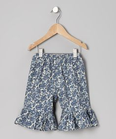 Take a look at this Ivory & Navy Perfectly Paisley Ruffle Shorts - Infant, Toddler & Girls by Carolina Kids on #zulily today!