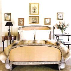 Give your bed a touch of warmth and comfort by adding a fur throw. It creates a beautiful and inviting visual to the room.