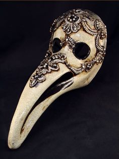 "Victorian Plague mask. The ""beak"" would be filled with herbs, etc which were thought to protect a person."