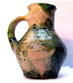 Pottery small rounded jug; green glazed. 14 Century (?)