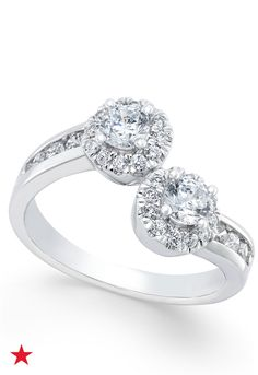 Brilliant round-cut diamonds shine in this combination channel and claw-set Two Souls, One Love two-stone diamond engagement ring (1 ct. t.w.). It's all beautifully designed in glimmering 12k white gold. Check it out at macys.com.