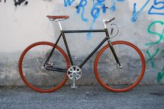 ucycles custom builds fixed-gear bike with ghisallo wood wheels