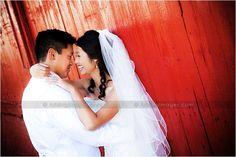 Michigan Wedding Photographers  www.ArisingImages.com  red barn and bride and groom