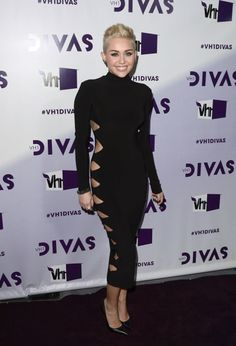 December 16, 2012 Miley Cyrus arrived at the VH1 Divas 2012 in a black turtleneck dress with diamond cutouts down the side by Omo by Norma Kamali. Black pointed-toe Jean-Michel Cazabat heels and Lorraine Schwartz jewellery finished off her look.