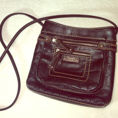 Tignanello black crossbody handbag Beautiful small sized black faux alligator print handbag, only worm minimally and zero signs of wear or damage! Make an offer !! Bundle 2 or more things for 15% off Tignanello Bags Crossbody Bags