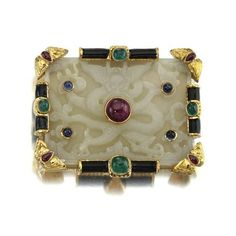Enamel, jade, sapphire, emerald and ruby pendant/brooch, David Webb. photo Sotheby's