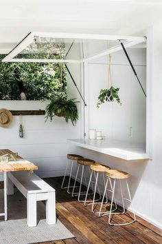 This is the style of servery we'd like, one benchtop from inside to out and this type of opening window