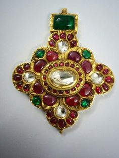 Pendent studded with rubies emeralds and  flat diamond .