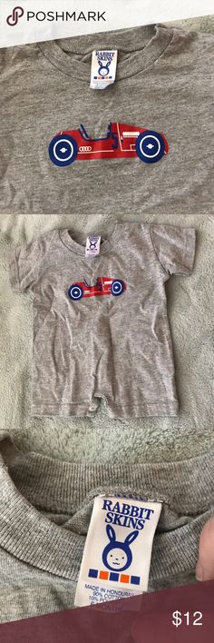Never worn Audi racer romper 🚗 This romper was washed but never work. Made of a cotton-polyester blend, it's a little on thicker side of the material. The size is marked per the tag as 6 months but it appears a little on the small side to me. It has since been discontinued from the Audi catalog so please keep that in mind when making your purchase. One Pieces Bodysuits