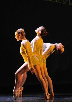 Absolutely beautiful image of 3 female dancers' legs. What symmetry, strength & beauty!