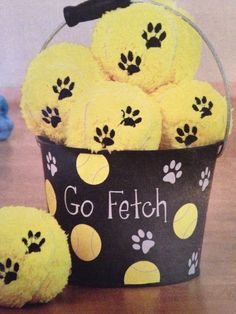 Super cute gift idea! Could totally DIY this! Dog Fetching Bucket for tennis balls