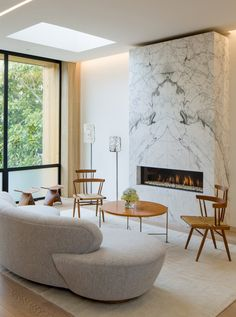This living room features a fireplace with a stone surround, in a home in San Francisco.