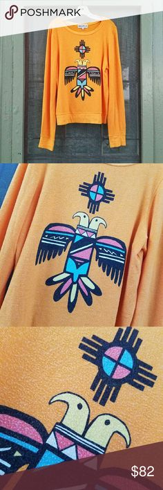 """{Wildfox} Blazing Sun jumper. One of my favorite tribal prints by Wildfox, it reminds me of totem art made by Native Americans in the Pacific Northwest.  The color, """"Cactus Cooler"""" is a vibrant light orange. Photos one and four are accurate.   Excellent pre-owned condition, only normal signs of gentle wear and careful washing. Still soft to the touch, but feels nicely broken in.  Tagged medium, will work for extra-small through perhaps petite large.   Measured length: 27.5."""" Wildfox Tops…"""