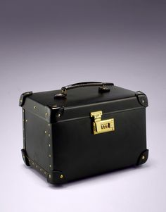 Luggage by Agent Provocateur - Vanity Case BlackVanity Case Black $1190 Stylish and luxurious, this ultra chic vanity case is perfect for a romantic getaway or to keep at home in your boudoir. Hand made in black matte with gold brass clasps, the case has a leather carry handle and stands on brass feet to safeguard its longevity.