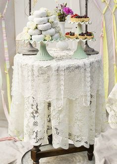 For a quintessentially Shabby or Cottage Style event, layer a variety of lace tablecloths, runners and ribbon over your table top. Shown here with our ceramic cake pedestals. All items sold separately.