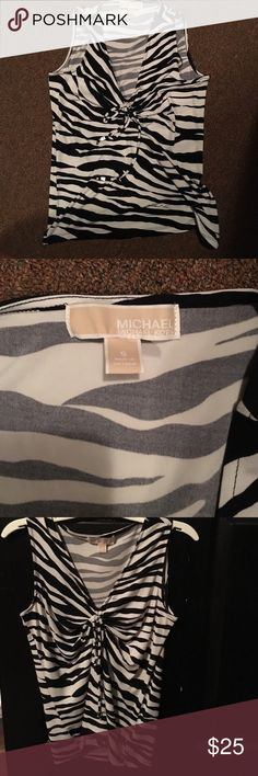 MICHAEL KORS animal zebra print shirt/tank top Size small. Worn once or twice. No stains or anything. Great condition. Lightweight and perfect for summer! There is a tie in the center of the shirt that has silver hardware ends. Michael Kors Tops Tank Tops