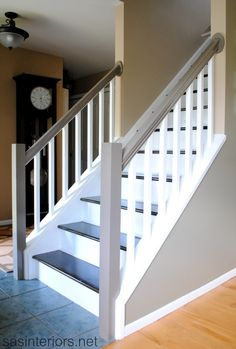 How to redo stairs from carpet to wood. Featured on remodelaholic.com  #stairs #carpet #stain