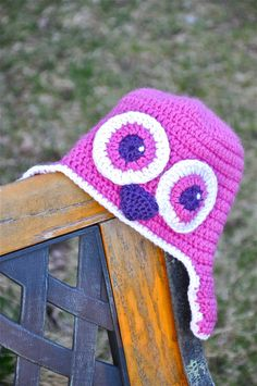 Crochet cap for a baby, made to look as an owl.