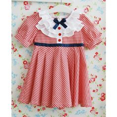 Adorable Vindie Baby picnic dress. Plaid short sleeve dress for your little girl. www.vindiebaby.com