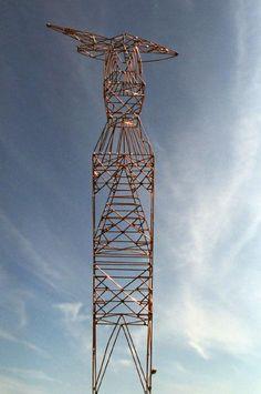 Pylon design. Innovative solution for transmission lines.  Pylon-sculpture, electricity tower like human figure for future transmission grids.   Sculpture: Copper, soldering.