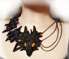 Polymer clay dragon neckpiece--the front is cool, but click through to look at the back!  Maybe not very wearable, but striking!
