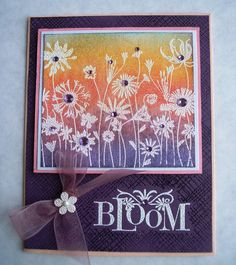 bright and beautiful card ... great example of emboss resist method...white embossed meadow flowers with purple/pink/orange sponged color...like the bling of various sizes of purples gems...