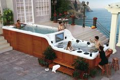 Double Decker Hot Tub with TV and Bar.  Could live in this thing!