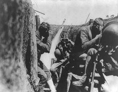 """U.S. soldiers are seen in a trench putting on gas masks in an undated World War One photo. World War One pioneered many """"firsts"""" in technological, scientific and societal innovations. Chemical weapons in the form of deadly poison gases were used for the first time, leading quickly to the development of countermeasures like the first gas masks. (REUTERS/Handout via U.S. Library of Congress)"""