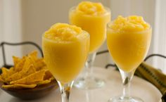 4 servings (1 cup each)  IngredientsOne 10-ounce bag frozen diced mango  2/3 cup tequila (preferably silver, 80 proof)  1/4 cup fresh lime juice  2 tablespoons orange liqueur, such as Cointreau  2 tablespoons superfine sugar  2 cups ice waterDirectionsPut the mango, tequila,