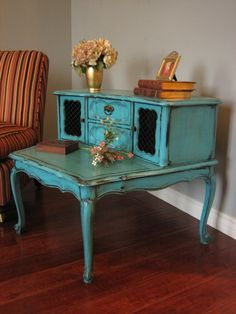 Beautiful piece! Two tiered end table in turquoise teal with distressed finish. More pics in link. Painted furniture / makeover / redo