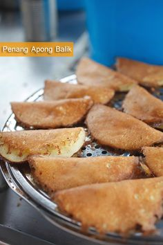 Penang... Apong Balik is a Nyonya sweet treat with sliced bananas, some corns, all folded up in a sweet, eggy, aromatic, soft and fluffy pancake, speckled with shredded coconut.