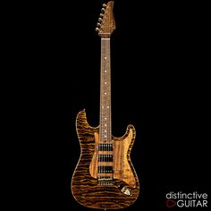 Suhr Classic Custom in Black Gold available at distinctiveguitar.com.