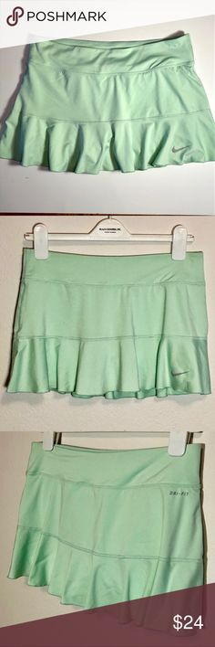 """Nike Medium mint green ruffled tennis skirt skorts Nike Dri-Fit size Medium light mint green ruffled tennis skirt skorts. In very good used condition. No rips, holes, tears or stains. Smoke free home.  Skirt: 87% polyester, 13% spandex. Shorts: 92% polyester, 8% spandex. Measurements: 30"""" waist, 7.5"""" Rise. 4"""" inseam.  BUNDLE SPECIAL: 15% off 3 or more items from my closet! Nike Shorts Skorts"""