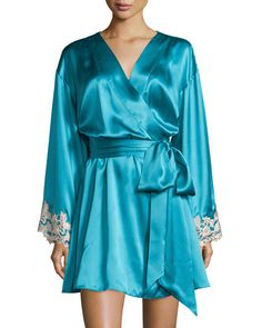 """La Perla """"Maison"""" short robe with lace-trim at cuffs. Shawl collar; open front. Long sleeves with scalloped edges. Self-tie belt at natural waist. Relaxed silhouette. Straight hem. Silk/viscose/nylon/polyester. Made in Italy."""