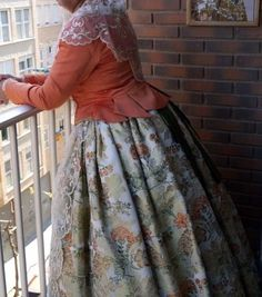 Mantle (manteleta), tabbed bodice, brocade skirt.  Perfect to period