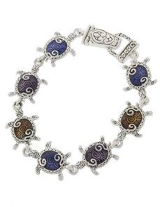 Silver tone and multicolored link style turtle bracelet with magnetic closure. 7 7/8""