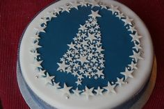 Stars and Sparkle Christmas Tree Cake - love the design. Shows how to marzipan annd ice cake (neatly)