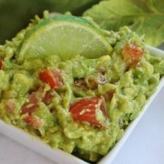 **Easy Guacamole w/ tomato, onion, garlic, and lime; (I used red onion& baby tomato) Can also add 1/4 tsp cumin. Extra: Use only the juice of 1/2 a lime. Add chopped cilantro, green scallions, splash of olive oil, capful of white vinegar, Pace salsa,& 1 tbsp sour cream for creaminess. Tips to prevent browning: keep avo pit in guac when in fridge, keep covered in non-clear dish, covered with foil or solidcolor lid. light from the fridge when you open door causes rxnand browns guac faster.