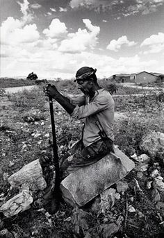 Sertão, 1987 • The land and people of my ancestors. • Brasil • We drove by men like this, resting on a rock, every hour or so. Otherwise, just cows and beautiful land.