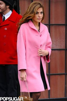 Pop of Pink: Eva Mendes wore a bright pink coat out in NYC on Monday.