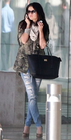 Selena Gomez carried the Dolce Miss Escape Tote as she  chats on her cell phone while dropping by her talent agency CAA on Tuesday (January 8) in Century City, Calif.