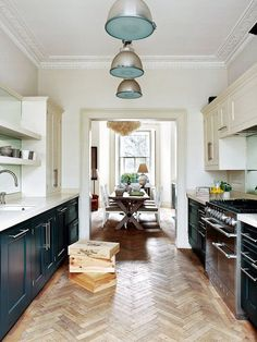 Kitchen Interior Design Remodeling 8 Amazing Galley Kitchens—and How to Make the Most of Yours via - These small kitchens are quite impressive with their ingenious design. Read on to see these 8 galley kitchen for yourself. Kitchen Inspirations, Home Decor Kitchen, Herringbone Wood Floor, Kitchen Flooring, Home, Victorian Homes, Eclectic Kitchen, Kitchen Remodel, Kitchen Renovation