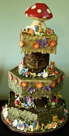 This fairy wedding cake is absolutely amazing! So much detail, it really does look like a magical woodland scene!