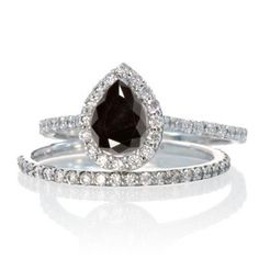 Pear Cut Black Diamond Halo Bridal Set for Woman. The sparkle of Black Diamond Gemstone along with glittering diamonds in this beautiful Black Diamond and diamond engagement ring wedding set would make her fall in love. The inexpensive Black Diamond and diamond gemstone bridal ring would be an instant family haireloom.