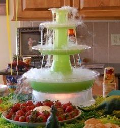 I love this foggy punch for a dinosaur party! Via Maddyson's Lane.