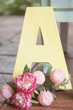 Yellow Monogram Letter with Pastel Flowers | Jessica Little Photography | Retro Candy Shop Anniversary Shoot