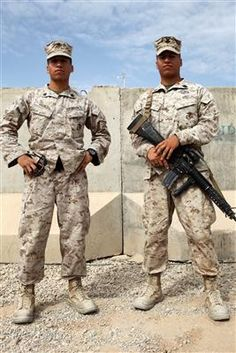 Sgt. David Haines, left, the Afghan National Army development chief, Afghan National Security Force Development, I Marine Expeditionary Force (Forward), and his twin brother Petty Officer 2nd Class Michael Haines, a corpsman with 1st Battalion, 1st Marine Regiment, reunite at Camp Leatherneck, Afghanistan.