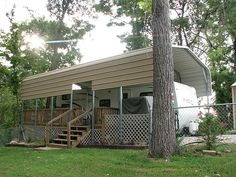 I would love to do this for my bus, but the wind would take it down fast! Deck and steps built for rv