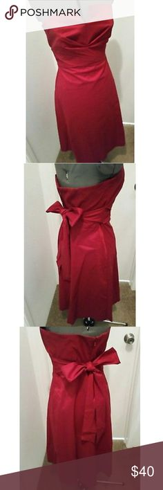 Donna Ricco dark red strapless dress This beautiful dress was worn once and is in like new condition.  The bust measures at 19 inches across and the length is 31 inches. Donna Ricco Dresses